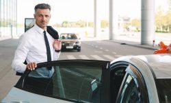 smiling-mature-businessman-getting-in-taxi-MQKY4WU-o2n412p3vhwpw3bboy7pe1wnc0llmlg19n88301tng